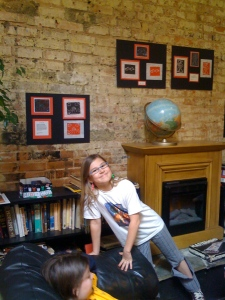 Emma at Banter with artwork behind her