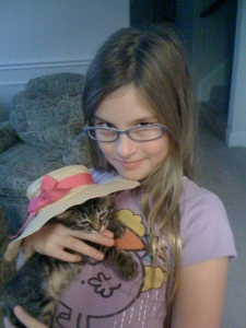 Emma dressed Nibbles in a hat